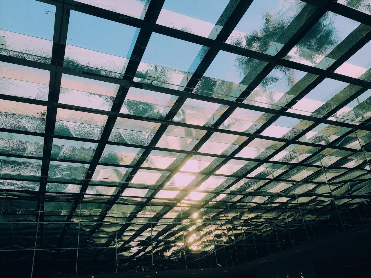 indoors, ceiling, low angle view, window, architecture, built structure, pattern, no people, modern, day, sky