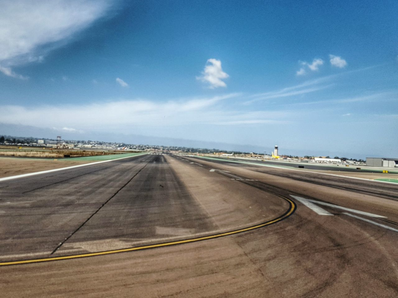 transportation, sky, day, airport runway, the way forward, road, outdoors, airport, blue, asphalt, dividing line, cloud - sky, airplane, runway, no people, nature