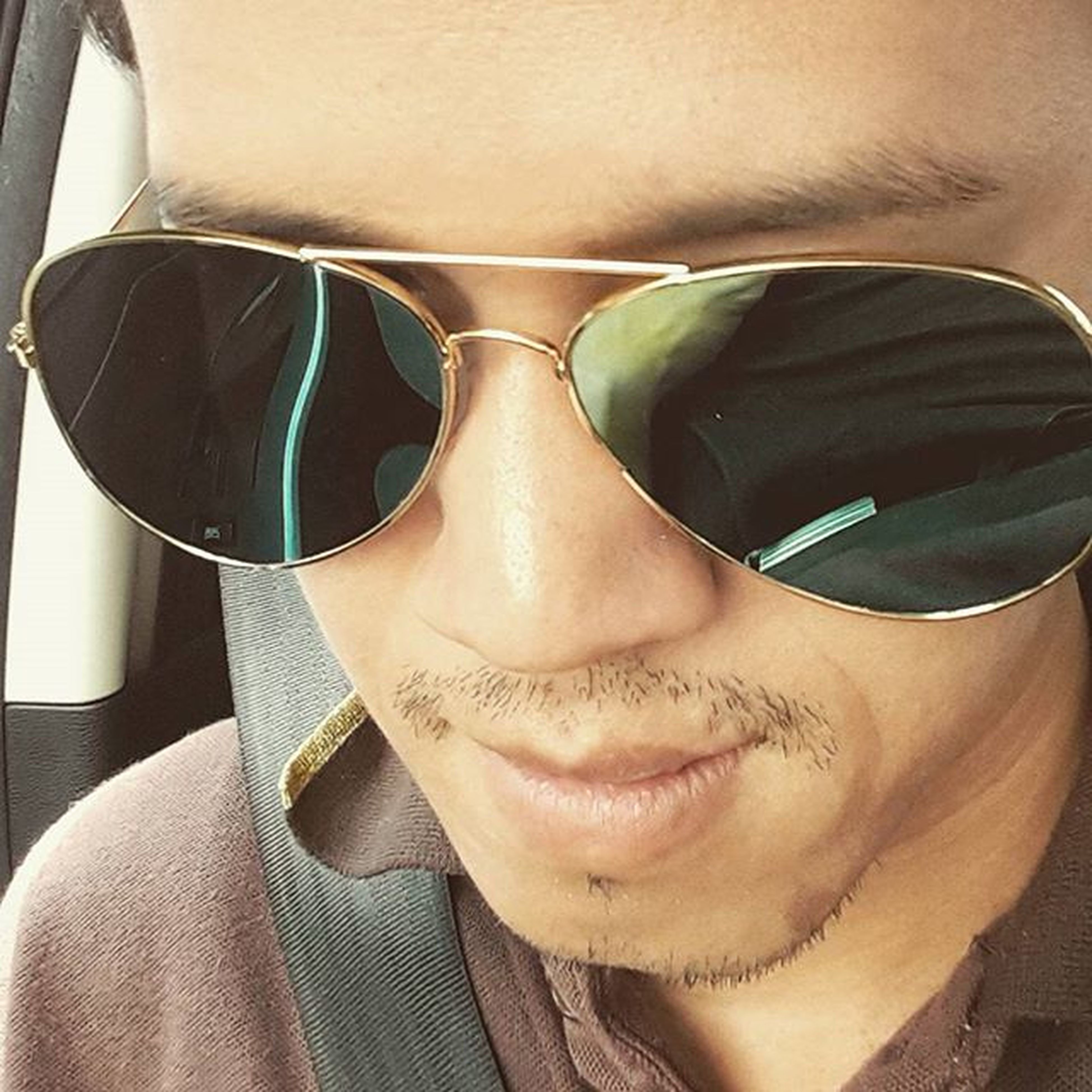 sunglasses, lifestyles, leisure activity, young adult, close-up, indoors, person, headshot, front view, reflection, casual clothing, looking at camera, portrait, eyeglasses, young men, wearing, relaxation