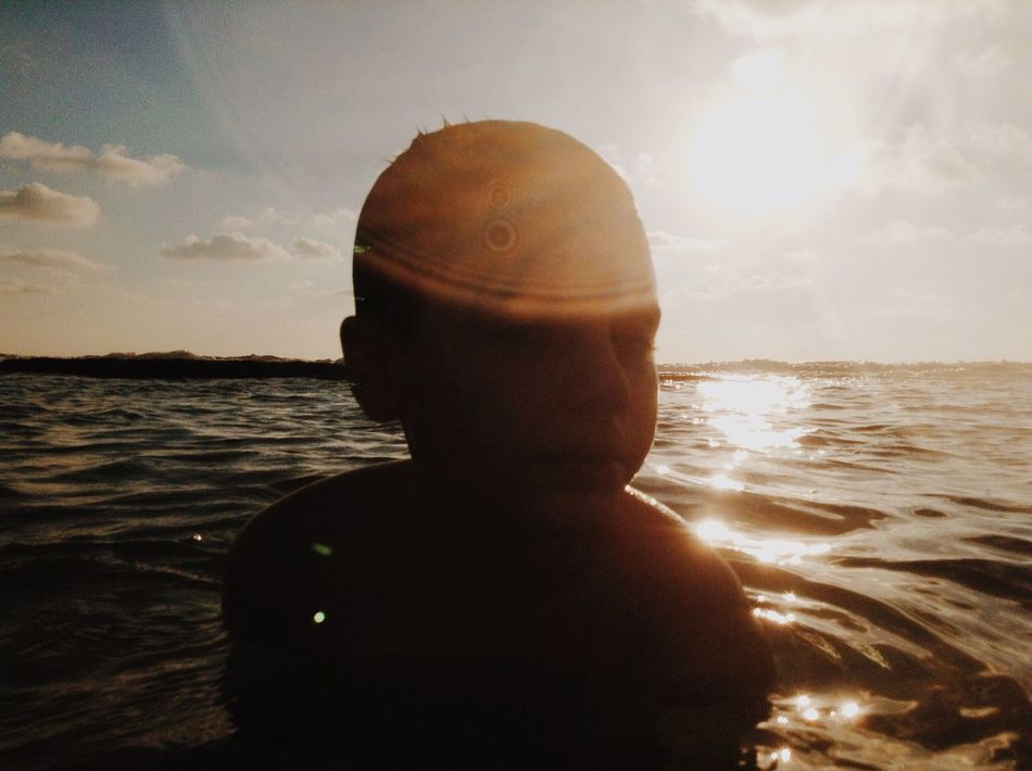Sea Water Sky One Person Shirtless Sun Childhood Sunlight Real People Nature Beach Sunset Vacations Lifestyles Beauty In Nature Outdoors Horizon Over Water Day Close-up People Ipod Shotonipod מייאייפוד מייגיא מייים TCPM