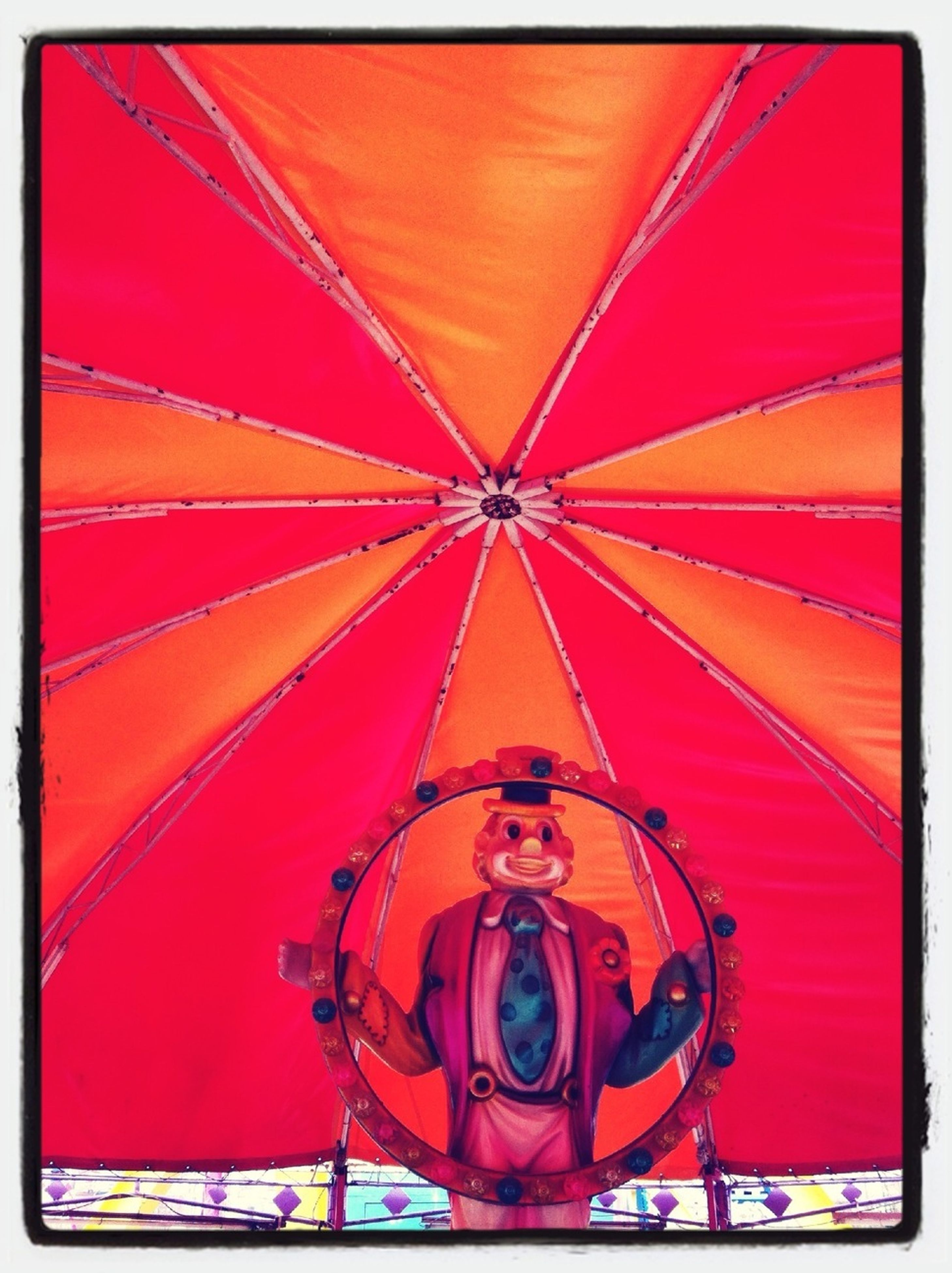 transfer print, auto post production filter, red, indoors, leisure activity, multi colored, lifestyles, low angle view, illuminated, front view, creativity, art, art and craft, ceiling, pattern, arts culture and entertainment, human representation, umbrella