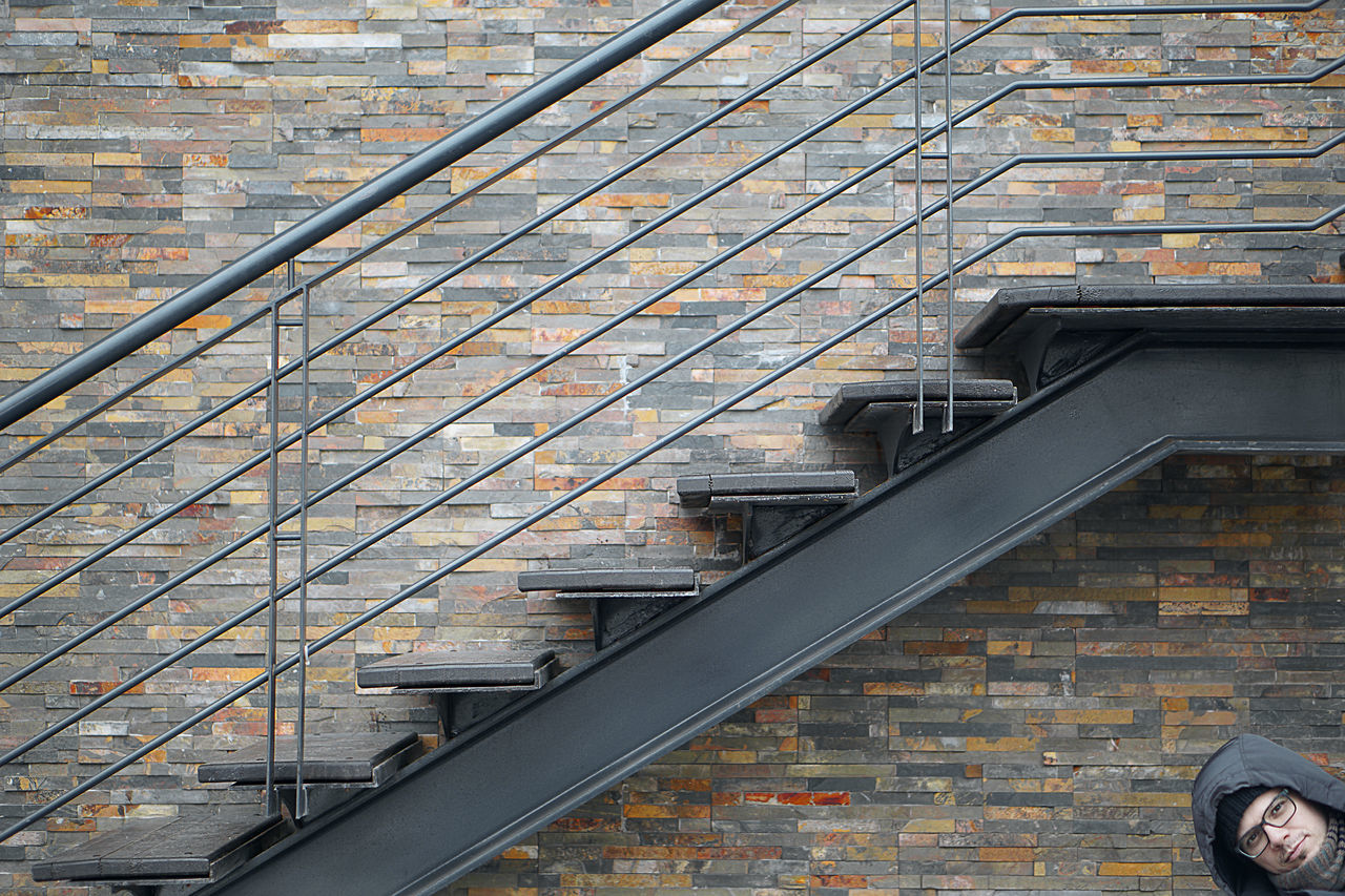 More grey. Steps And Staircases Architecture Minimalist Architecture Façade Urban Urban Geometry People One Man Only Staircase Built Structure Building Exterior Outdoors Grey Resist Art Is Everywhere The Secret Spaces Long Goodbye ミーノー!!