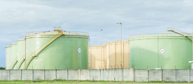 Industrial Storage Tanks. Oil tanks in two lines Building Exterior Chemical Container Energy Exterior Factory Industry Petrochemical Petrolchemical Plant Silo Staircase Storage Tanks Tank Warehouse