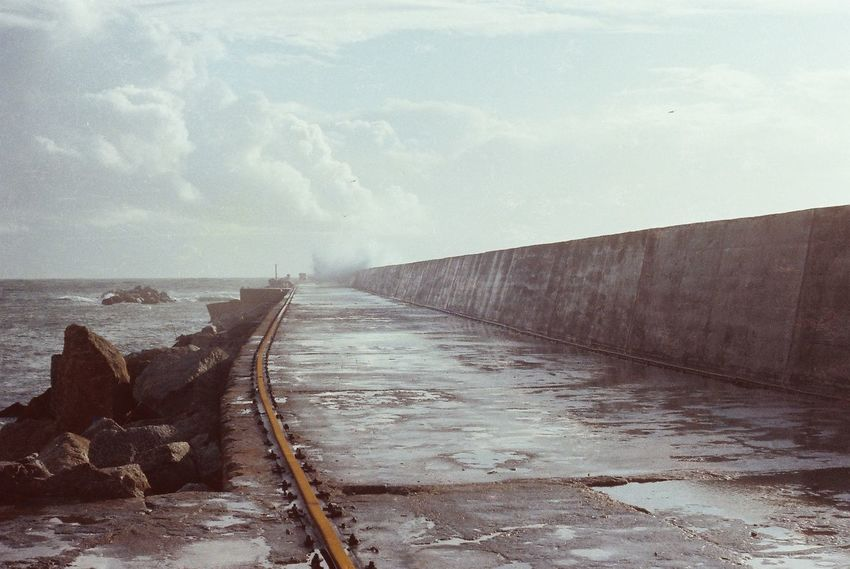 Cloud Cloud - Sky Day Diminishing Perspective Empty Footbridge Footpath Jetty Long Narrow Outdoors Rough Seas Scenics Sea Sky Solitude Surface Level The Way Forward Tranquil Scene Tranquility Vanishing Point Walkway Water 1979 Archive