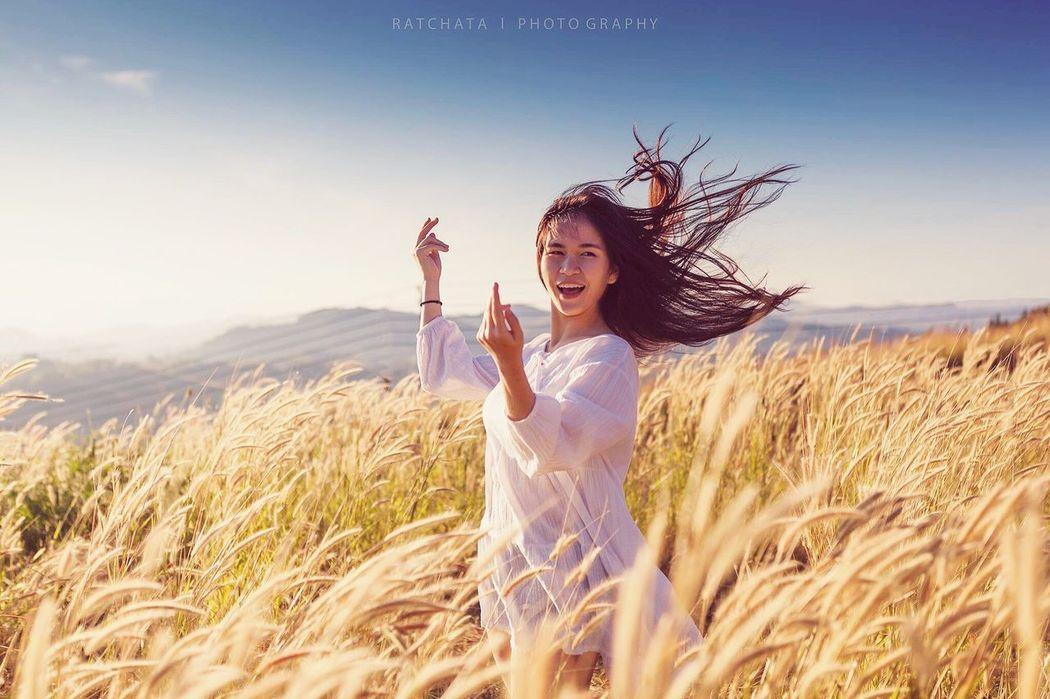 Asian girl relaxing at morning hill Young Adult Smiling Happiness Beauty Women Cheerful Cereal Plant Young Women Beautiful People One Young Woman Only Adult Carefree Freedom One Person Field Lifestyles Nature Wheat Portrait People