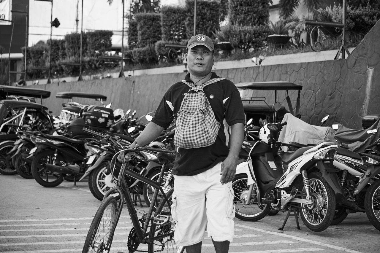 On my way to the city. A guy waiting to cross the road with his bike. Casual Clothing City City Life Land Vehicle Lifestyles Mode Of Transport Motorbike Motorcycles My Commute Outdoors Pampanga Parked Portrait Street Photography Street Portrait Eyeem Philippines EyeEm Pampanga Feel The Journey Natural Light Portrait Showcase June Monochrome Photography