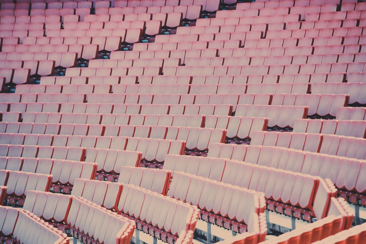 EyeEm LOST IN London High Angle View Full Frame Backgrounds Outdoors No People Day Architecture Building Exterior Arsenal Stadium Football Seats Empty Red Chairs Fans Soccer Stadium London England Sports Empty Chair Open Edit