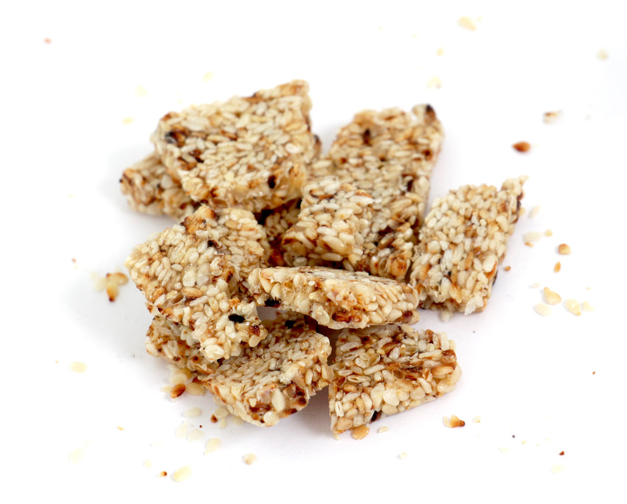 homemade sesame bar Bar Choped Leek Energy Food Food And Drink Healthy Eating Homemade Food No People Pieces Protein Bar Sesame Sesame Bar Sesame Seed Sweet Sweet Food White Background