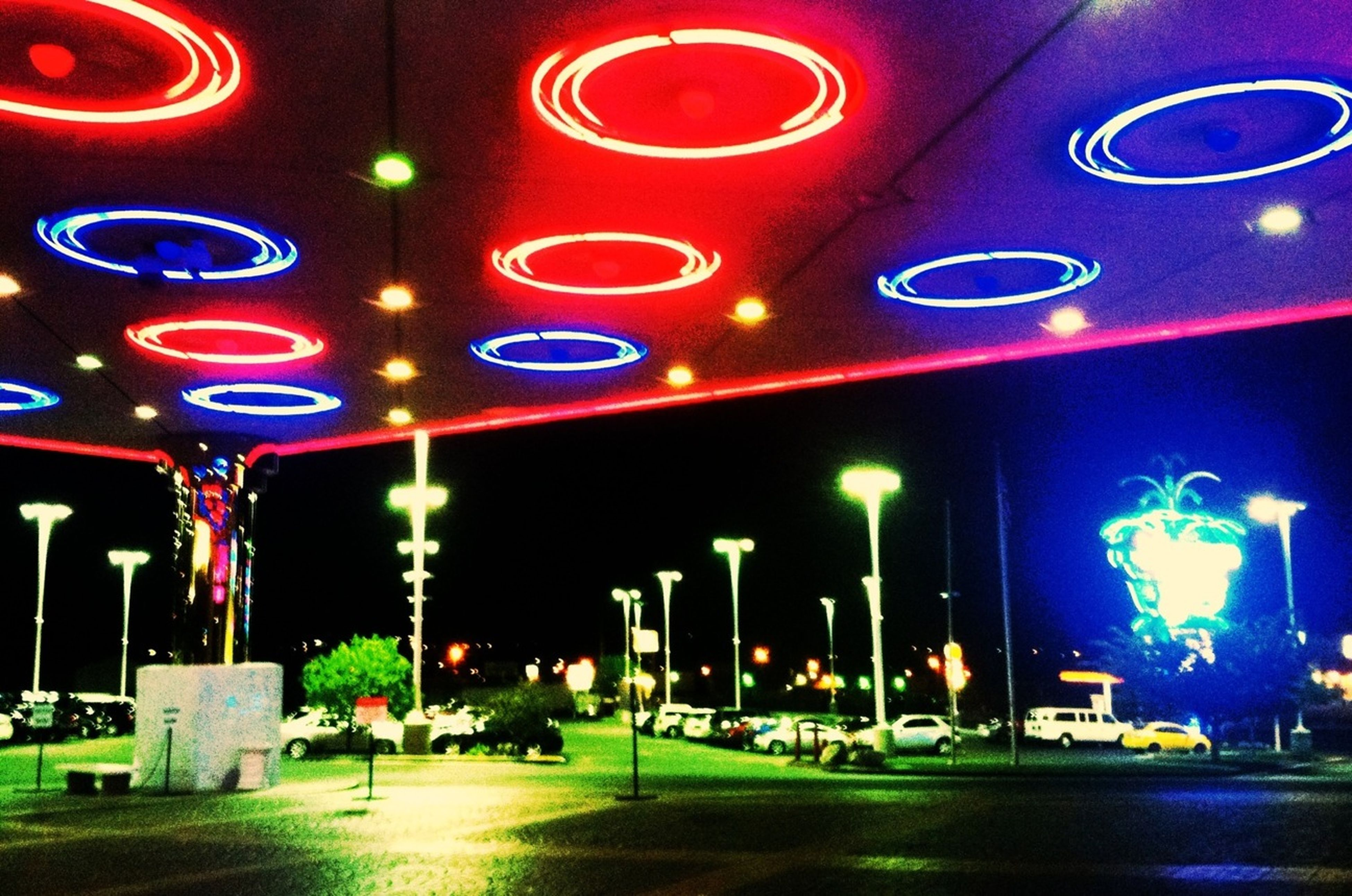 illuminated, night, lighting equipment, built structure, architecture, street, multi colored, building exterior, street light, road, in a row, city, outdoors, incidental people, green color, empty, electric light, no people, transportation, red