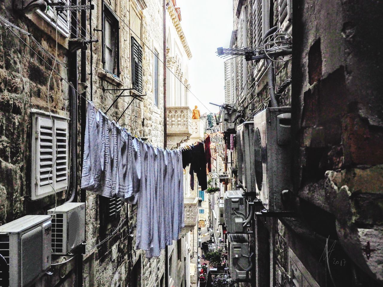 Building Exterior Architecture Drying Clothesline Hanging Clothing Built Structure Laundry Residential Building Alley Cloth Outdoors Textile Day City No People Sky