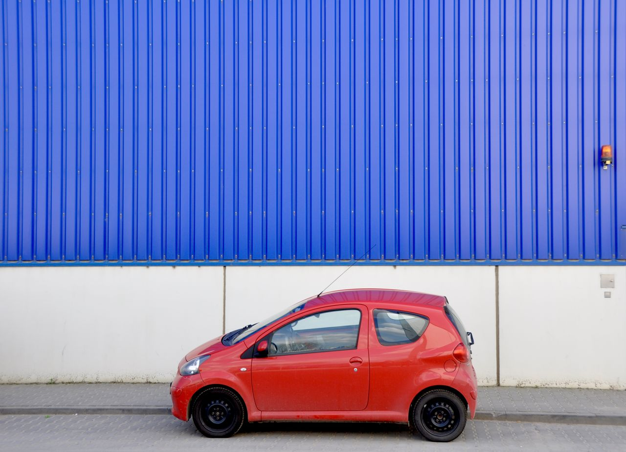 Blue Car Contrast Contrasting Colors Contrasting Textures Land Vehicle Mode Of Transport No People Outdoors Red Small Car Transportation