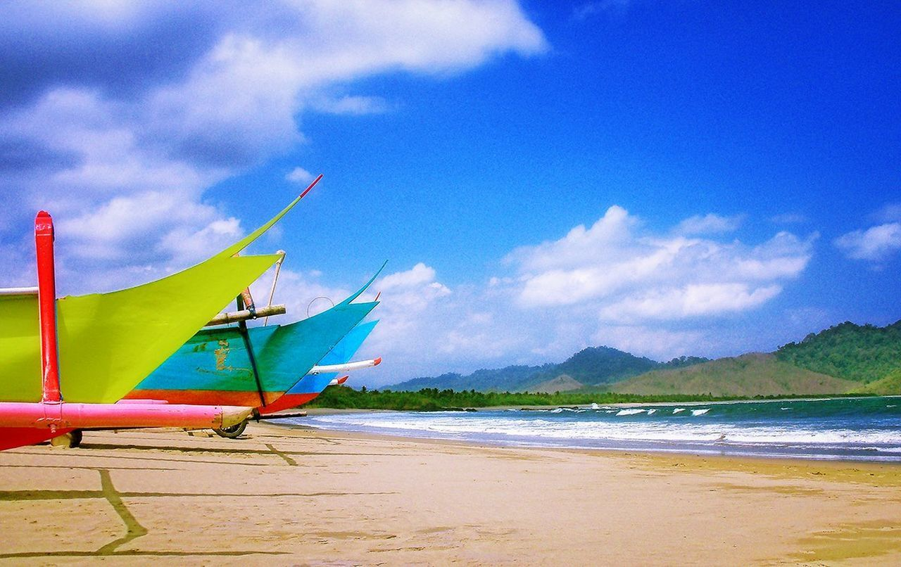 beach, sky, sea, shore, cloud - sky, water, sand, nature, beauty in nature, day, scenics, nautical vessel, tranquility, outdoors, mode of transport, transportation, tranquil scene, no people, longtail boat, outrigger, horizon over water