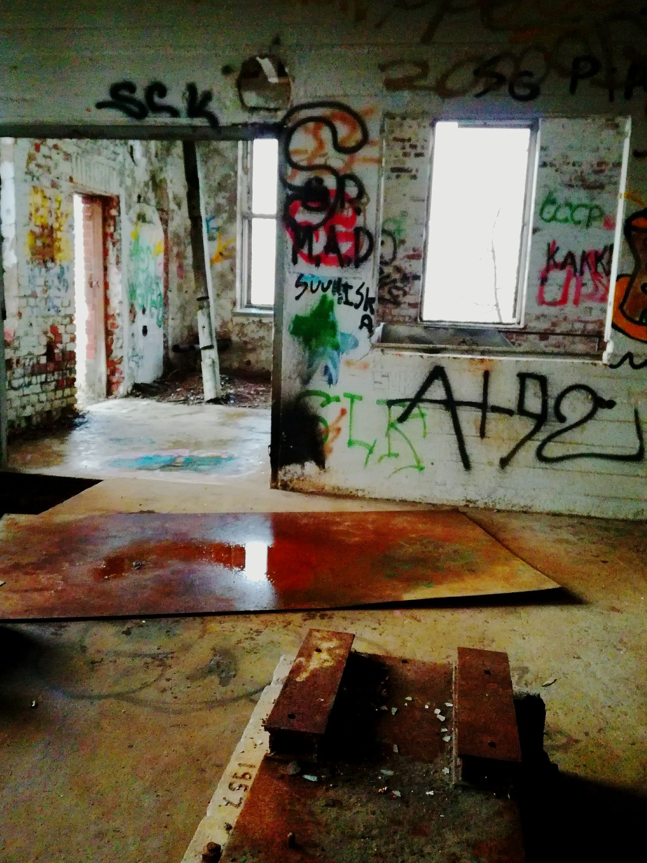 Multi Colored No People Architecture Window Text Abandonedplaces Halla Finland Light And Shadow Abandonedbuilding Glassless Window Industrial Exploring Adventuring Abandoned_junkies Local History Past Graffiti Walls Architecture See Through Colors Rust Empty Ruins
