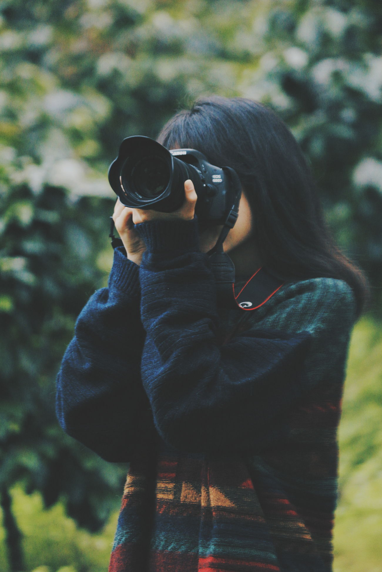 Adults Only One Person One Woman Only Women Adult People Only Women Real People Outdoors Day Warm Clothing Young Adult Human Body Part Indonesia_photography EyeEm Indonesia Close Up Technology Technology Close-up Camera - Photographic Equipment Tree