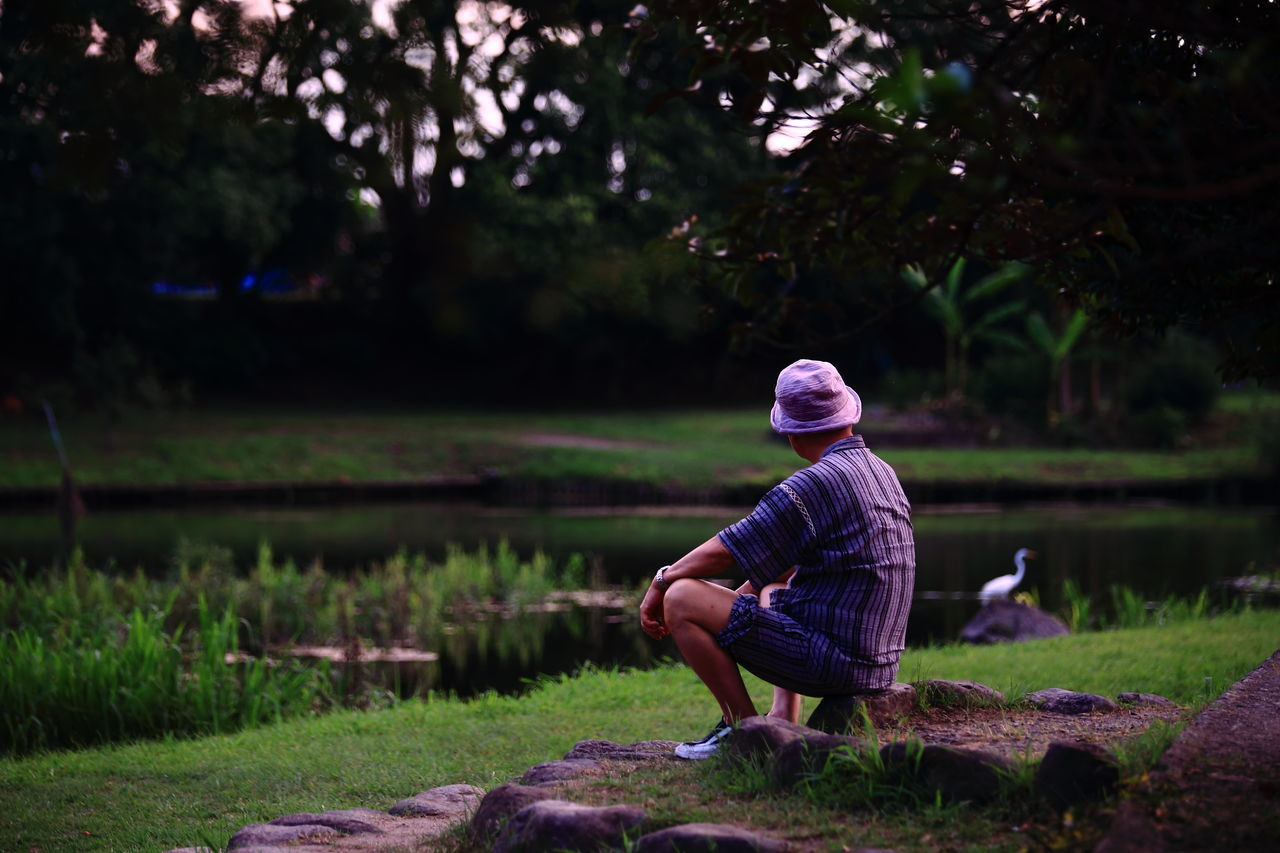 real people, rear view, sitting, outdoors, one person, nature, tree, day, childhood, full length, grass, beauty in nature, people