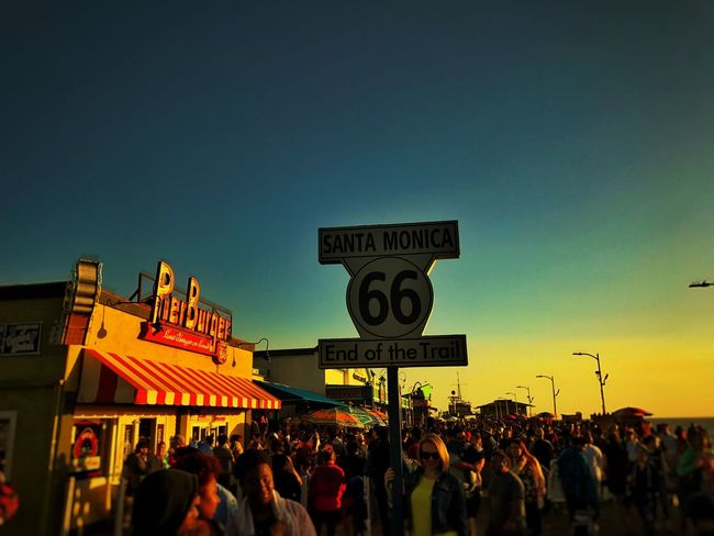 Route 66 Santa Monica Shotoniphone7plus Communication Text Western Script Large Group Of People Real People Women Men Lifestyles Crowd Architecture Outdoors Leisure Activity Placard Built Structure Protestor Building Exterior Day Road Sign Sky City The Great Outdoors - 2017 EyeEm Awards EyeEmNewHere Paint The Town Yellow