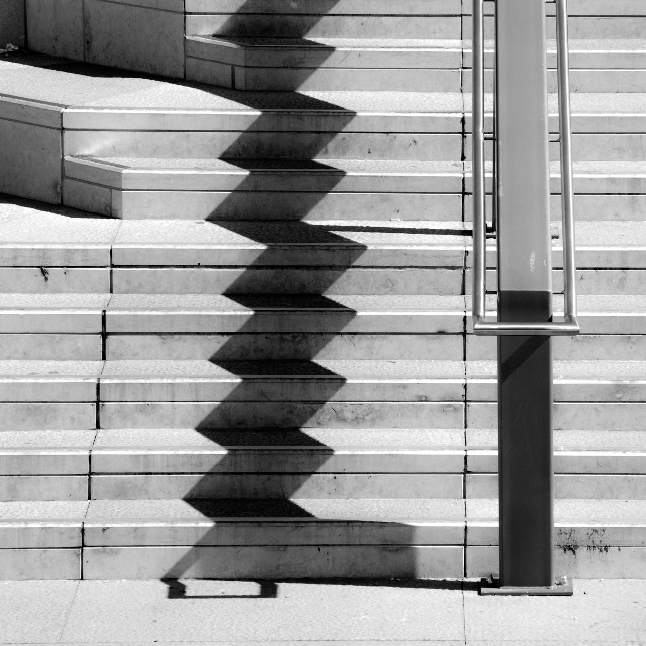 Stairs Shadowplay Architecture Blackandwhite Blackandwhite Photography Building Built Structure City Day Geometric Shape Modern No People Repetition Shadowplay Shadows Stairs Stairways Urban Geometry Urban Lines Pivotal Ideas The City Light Minimalist Architecture Premium Collection
