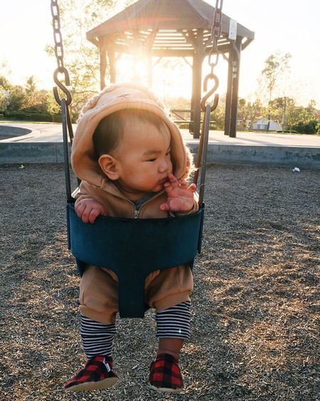 EyeEm Selects EyeEm Selects Real People Childhood One Person Baby Full Length Swing Babyhood Leisure Activity Lifestyles Tree Day Playground Toddler  Front View Outdoors Casual Clothing Park - Man Made Space Playing People