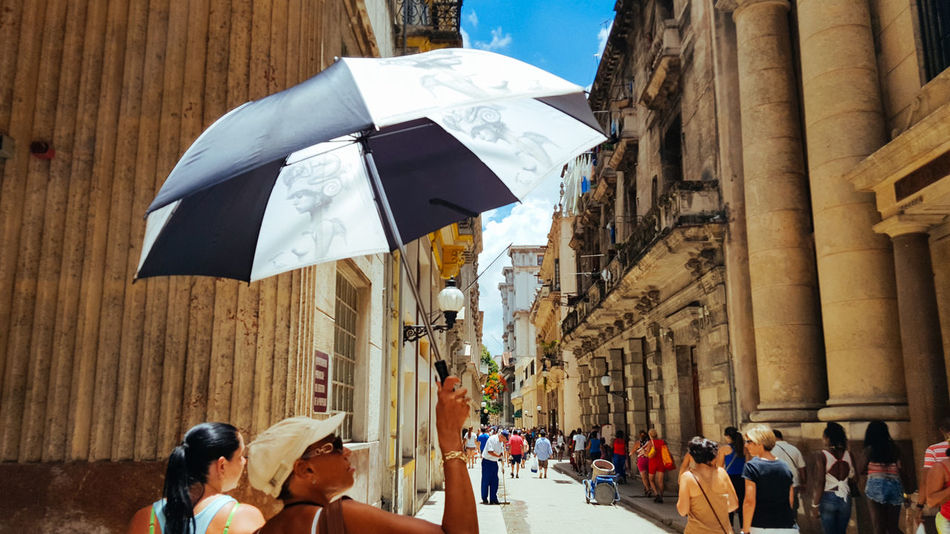 Sombrilla @La Habana Vieja Alley Architecture Building Exterior Built Structure City City Life Day Habana Habana Cuba  Habana Vieja Havana Narrow Outdoors Person Sky Sombrilla Street Sun Tall - High The Way Forward Umbrella Walking