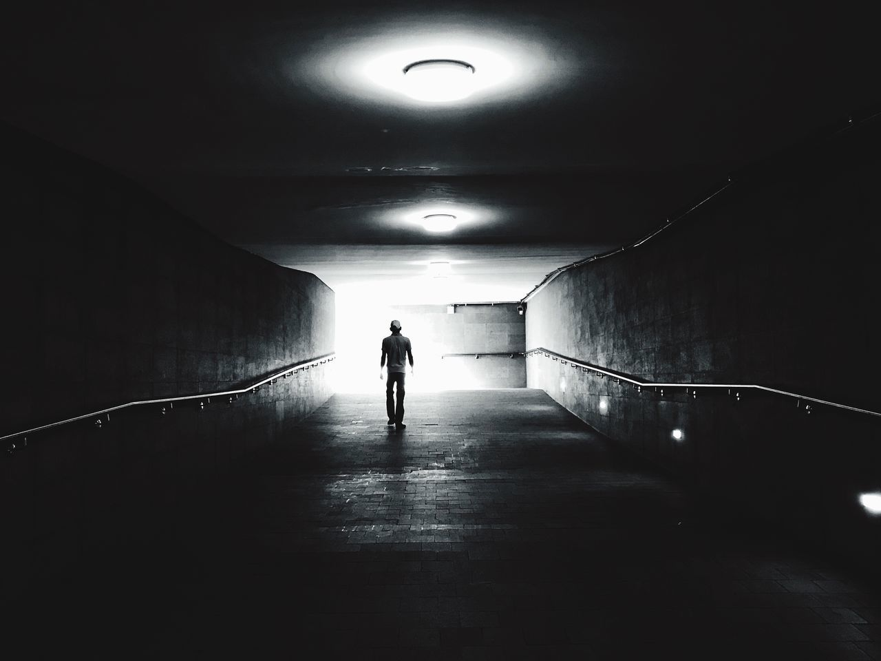 the tunnel Illuminated Tunnel Real People Full Length One Person Indoors  Architecture Built Structure Walking The Way Forward Leisure Activity Light At The End Of The Tunnel Underground Rear View Silhouette Lifestyles Men Day People