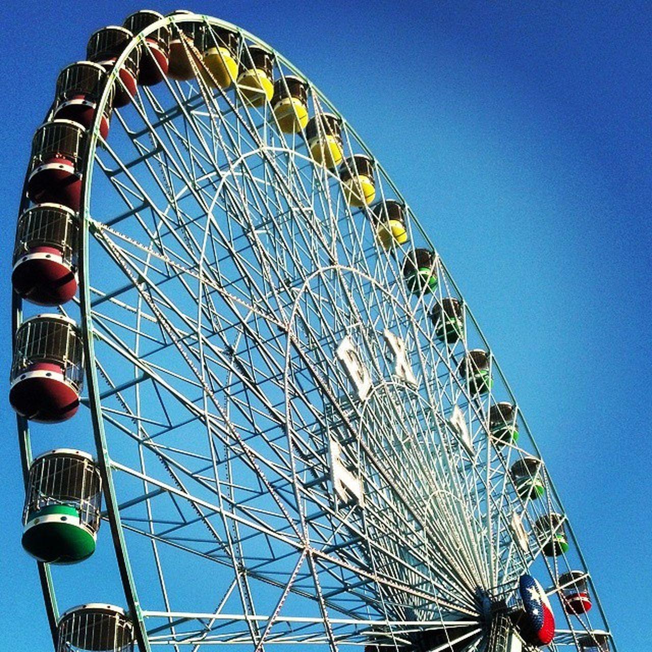 amusement park, arts culture and entertainment, ferris wheel, low angle view, amusement park ride, big wheel, blue, circle, clear sky, no people, built structure, day, sky, outdoors, architecture