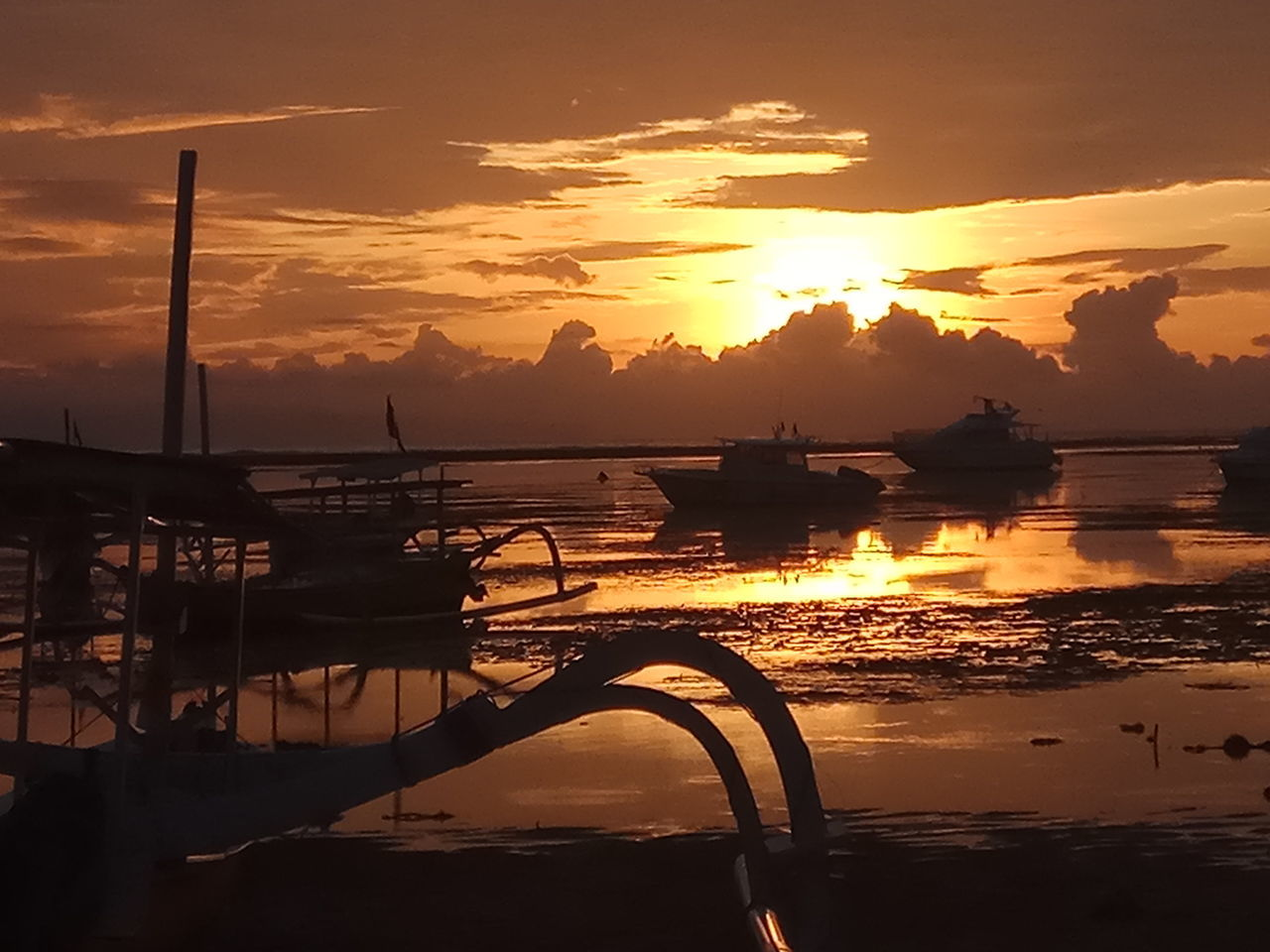sunset, water, nautical vessel, orange color, transportation, mode of transport, silhouette, sky, reflection, nature, beauty in nature, scenics, boat, cloud - sky, sea, moored, sun, tranquility, no people, sunlight, outdoors, sailing, outrigger