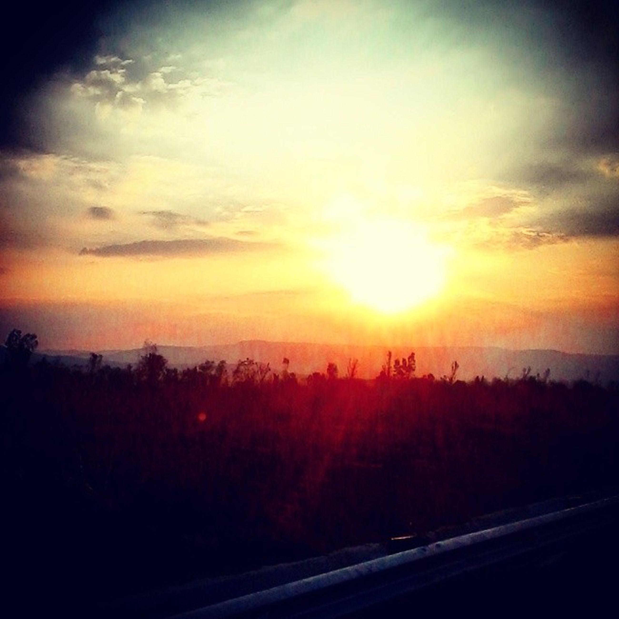 sunset, scenics, sky, silhouette, tranquil scene, beauty in nature, sun, tranquility, landscape, orange color, nature, cloud - sky, tree, idyllic, sunlight, sunbeam, cloud, outdoors, non-urban scene, no people