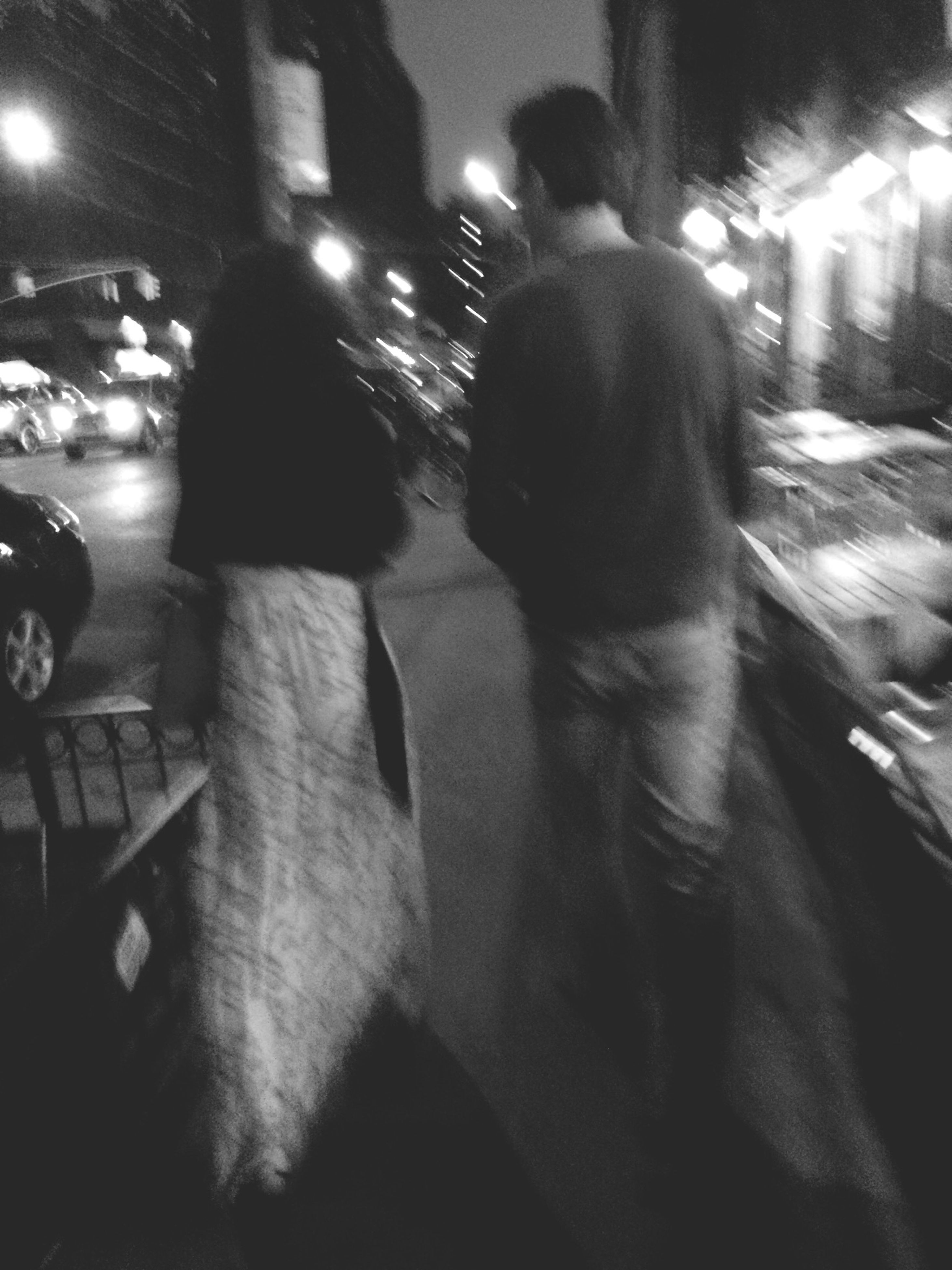 lifestyles, night, men, leisure activity, togetherness, illuminated, street, person, casual clothing, indoors, bonding, rear view, full length, walking, medium group of people, incidental people, city life