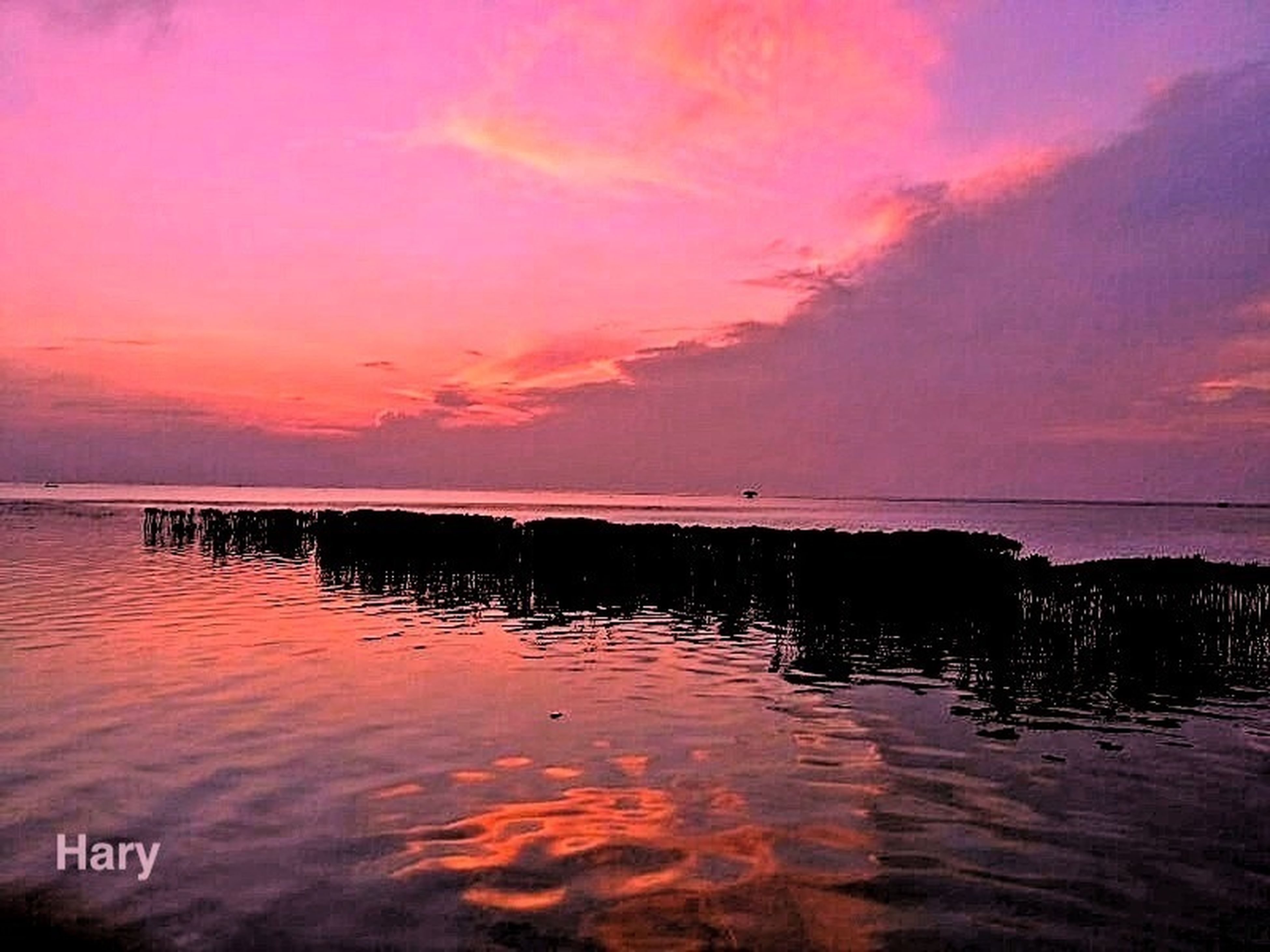 sunset, water, sky, tranquil scene, scenics, tranquility, reflection, sea, beauty in nature, orange color, cloud - sky, idyllic, horizon over water, nature, waterfront, cloud, silhouette, lake, beach, dusk