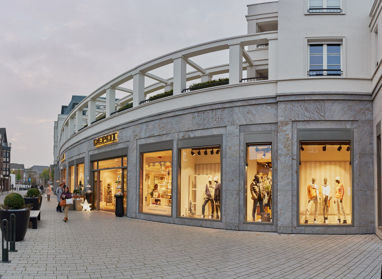KEMPEN, GERMANY - OCTOBER 26, 2016: Modern architecture hosts retail stores and attractive appartments. Atmospheric Mood Christanity Colorful Downtown Germany Heritage High Resolution Historic City History Light Love Market Medieval Outdoors People Relaxing Shopping Travel Destination Urban
