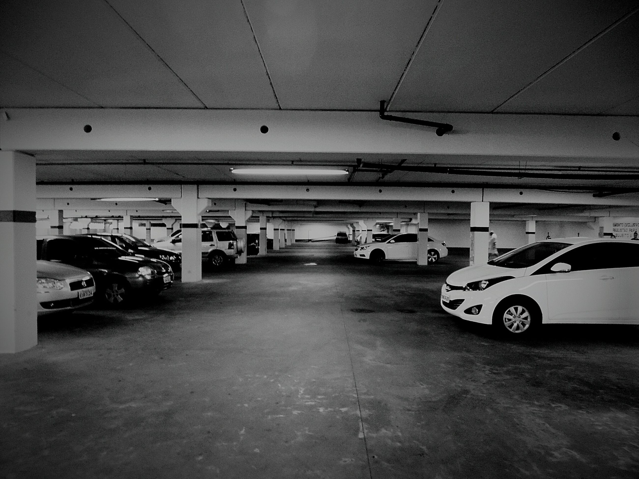 transportation, mode of transport, land vehicle, architecture, built structure, the way forward, travel, car, street, stationary, indoors, road, parking, diminishing perspective, bicycle, incidental people, parking lot, empty, public transportation, day