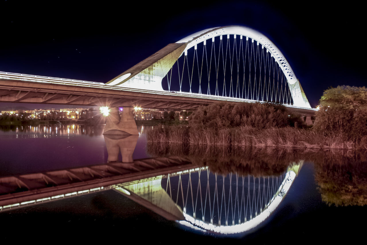 reflection, night, architecture, water, illuminated, bridge - man made structure, outdoors, built structure, no people, sky, clear sky