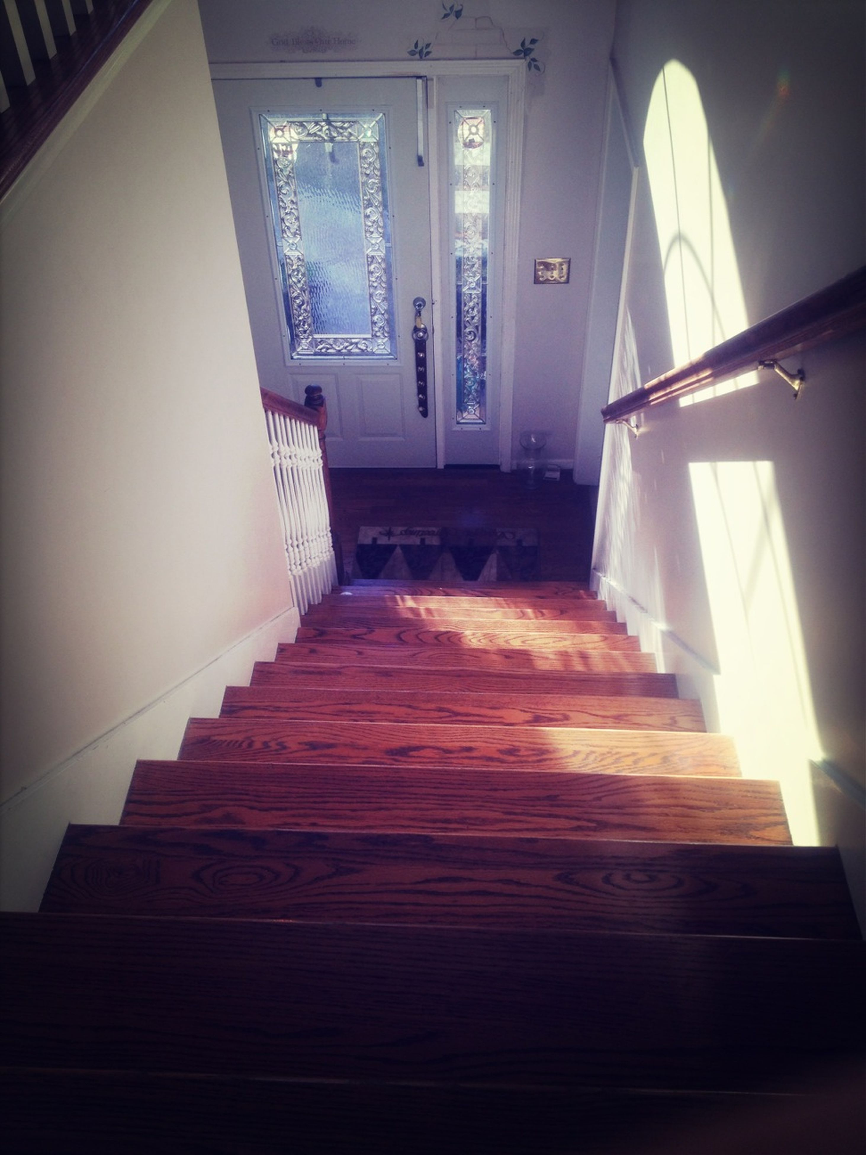 indoors, architecture, built structure, steps, staircase, house, home interior, steps and staircases, railing, window, absence, door, wood - material, empty, sunlight, corridor, no people, ceiling, low angle view, flooring