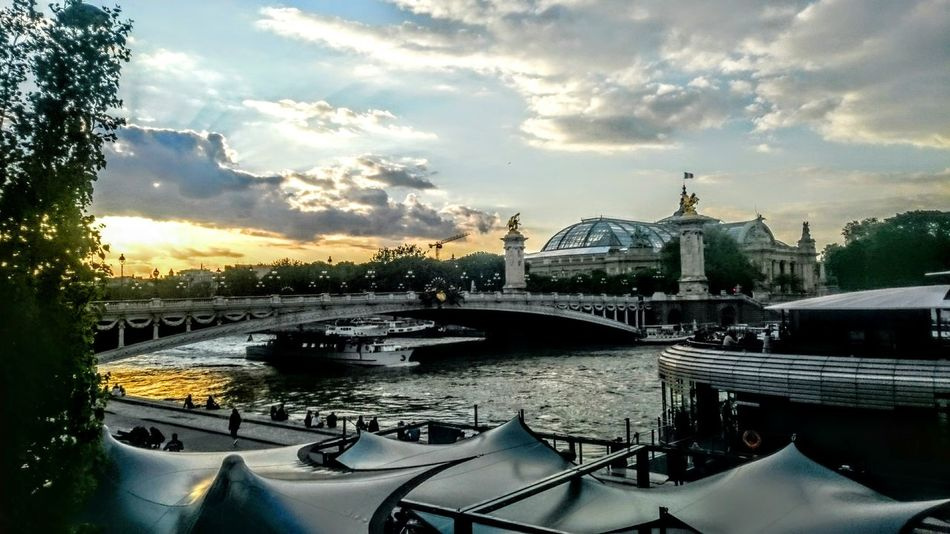 Paris Grand Palais Skies And Clouds Dusk Sundown Seine River View Paris Weather Tradition Meets Modern New Meets Old The Great Outdoors - 2016 EyeEm Awards River Bank View River Bank Cafe Tent Roof Cities At Night Feel The Journey Original Experiences