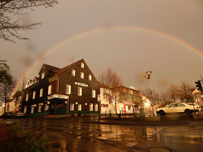 rainbow in Bergisch Gladbach City City Life Illuminated Nature No People Outdoors Rainbow Rainbow Colors Rainbow Sky Rainbows Rainbow🌈 Rainy Rainy Day Rainy Days Sky Urban Rainbow Urban Weather Urbanphotography Weather Weather Wet Street Wet Streets Wethered