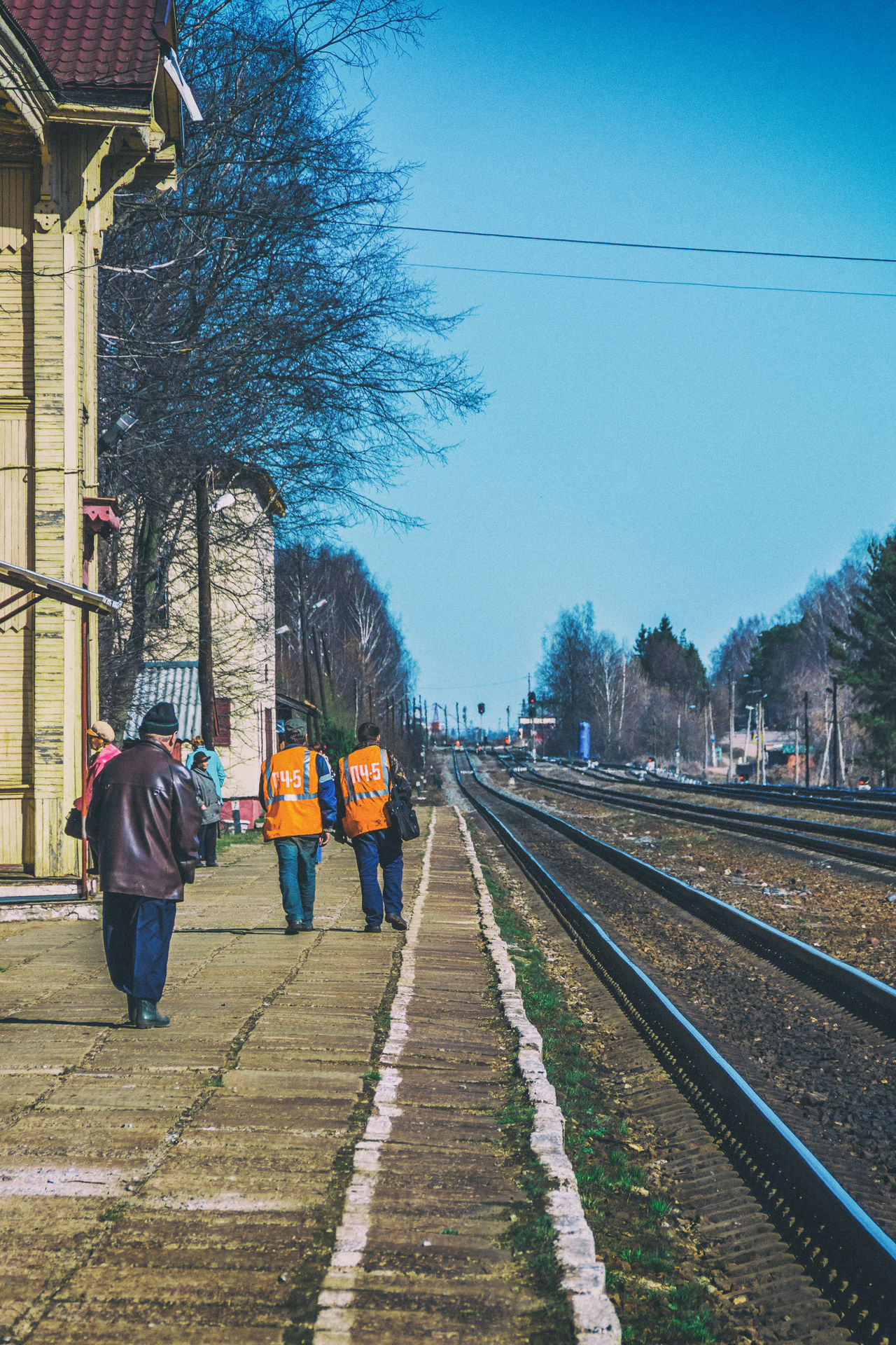 On the platform of the railway station, a small provincial town. Adult Architecture Blue Building Exterior Built Structure Day Large Group Of People Lifestyles Men Outdoors People Rail Railroad Railroad Station Railway Real People Sky The Way Forward Transportation Tree Walking