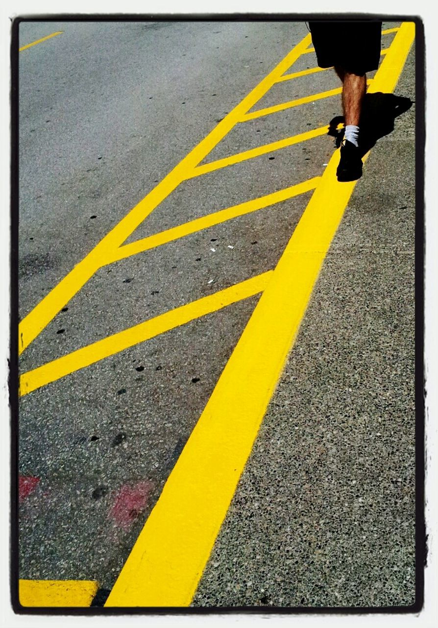 yellow, road marking, low section, one person, real people, road, transportation, human leg, lifestyles, asphalt, day, street, outdoors, men, bicycle, one man only, human body part, adult, people, adults only