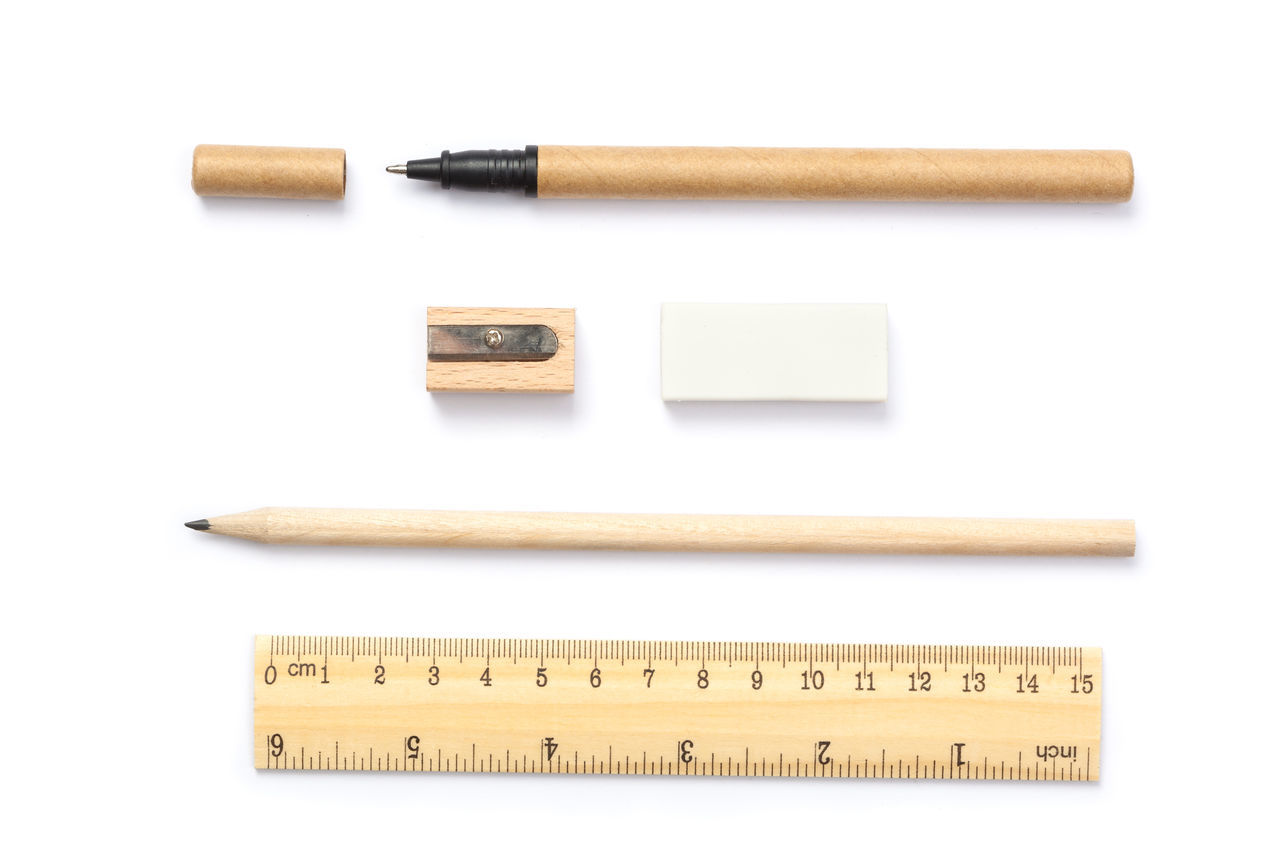 Set of Wood-carton made writing tools with cap, isolated on white Carton Drawing Eraser Friendly Isolated Lined Up Many Natural No People Pen Pencil Pieces Ruler Set White Background Wood Writing