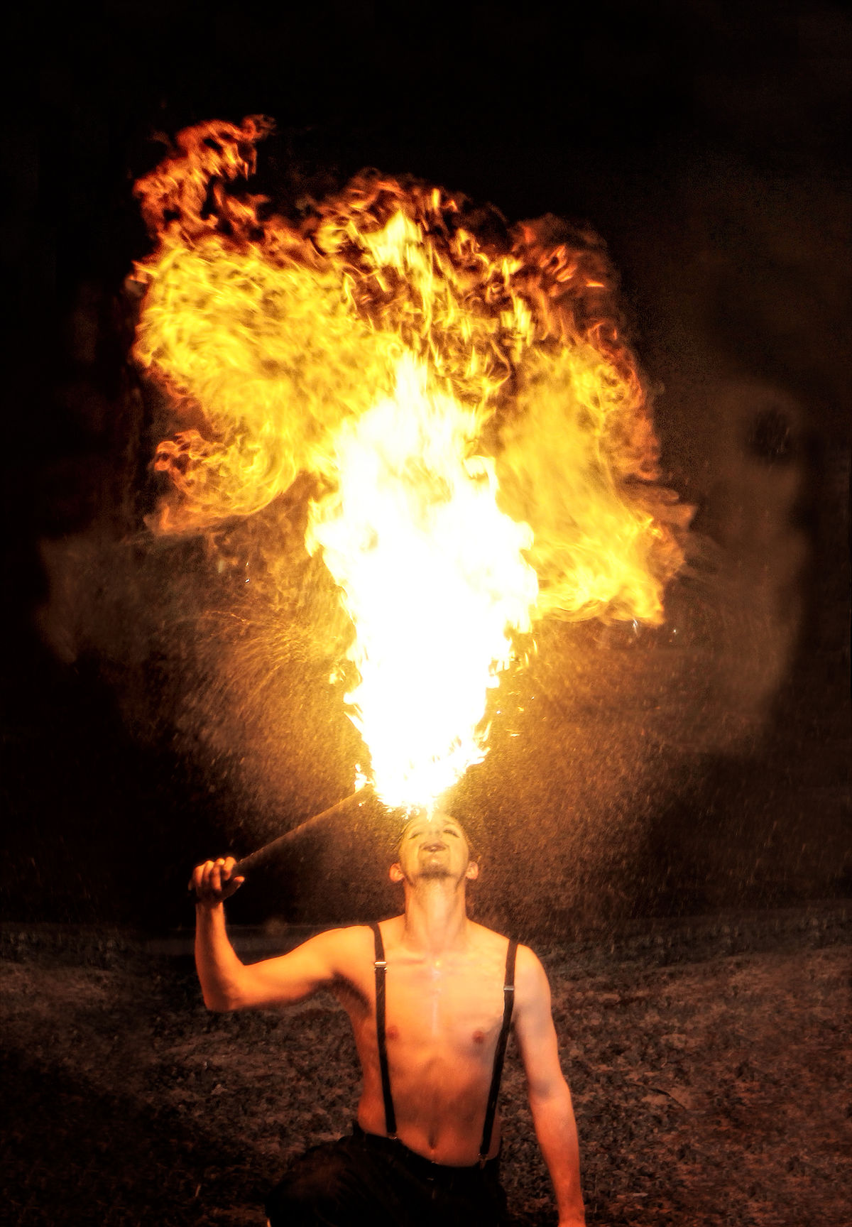 Professional circus performer breathes fire. Activity Ball Of Fire  Burning Circus Circus Performer Entertainer Entertainment Extreme Fire Breathing Fire Show Flame Flames Flaming Fun Glowing Heat Illuminated Live Show Orange Color Perfoirm Shopping Stunt Torch Tourist Attraction