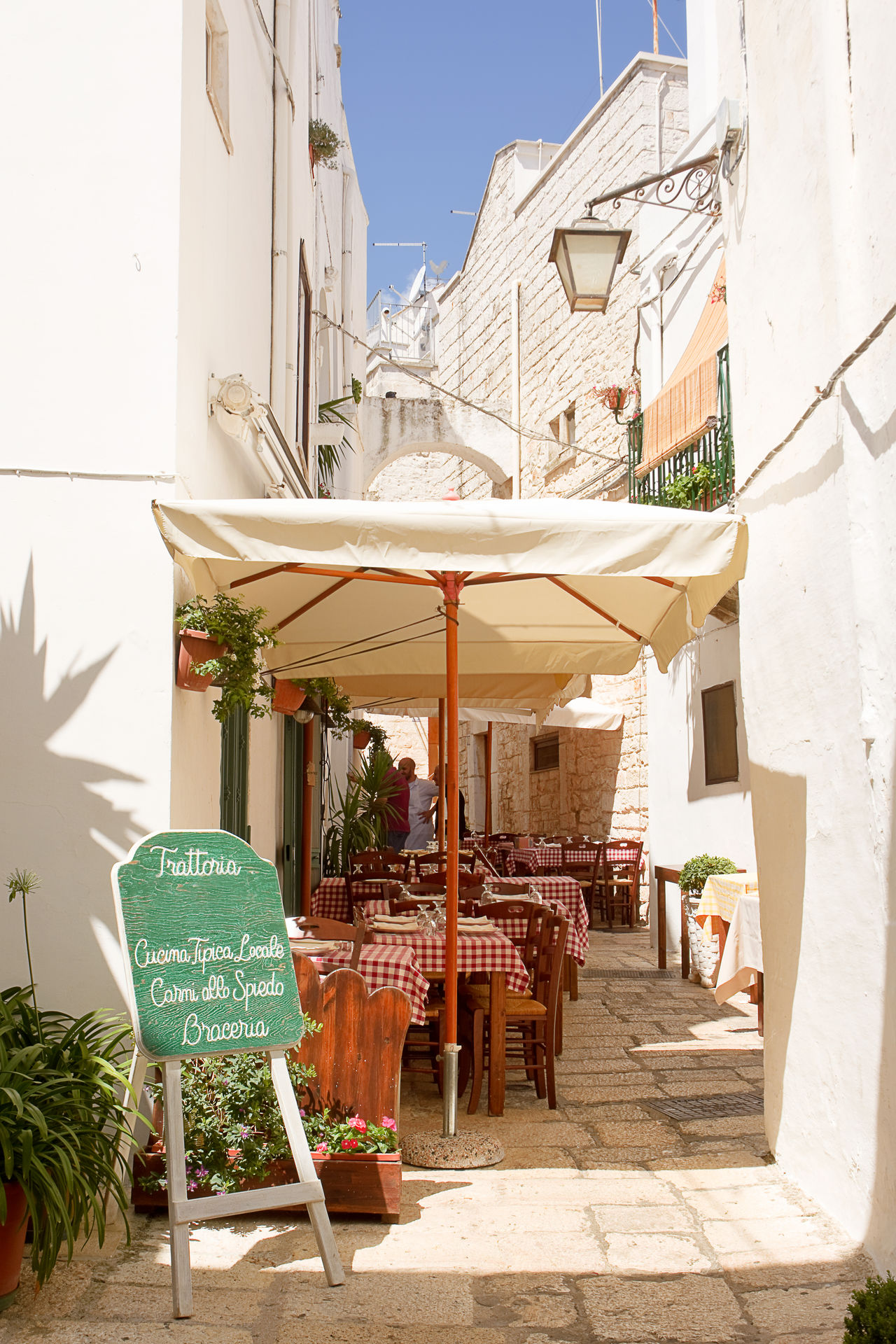 Table set in the alley of Cisternino (Apulia) Alley Apúlia Cisternino Cooker Dining Dinner Gazebo Glass Glasses Italy Itria Menu Napkin Ostuni Puglia Ready-to-eat Salento Set Table Tablecloth Tableware