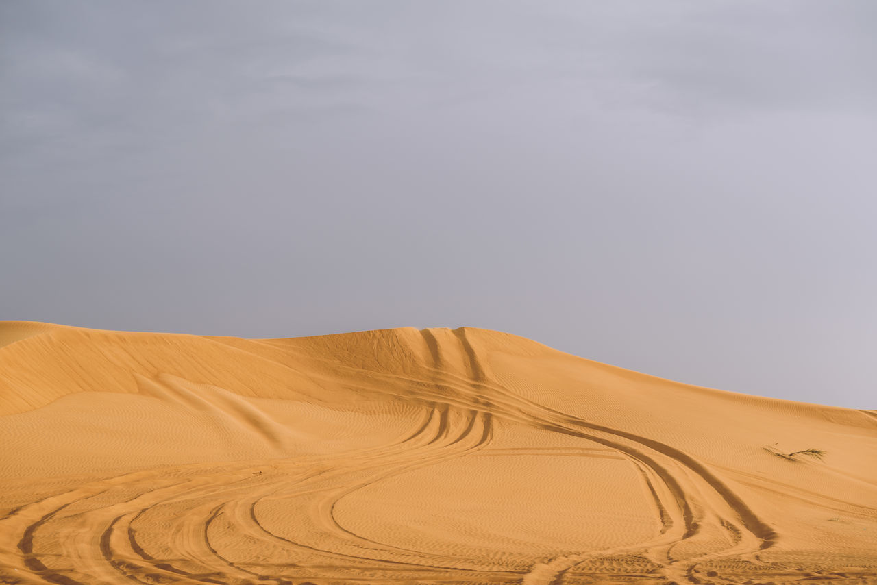 Arid Climate Awe Beauty In Nature Cloud - Sky Desert Dramatic Sky Dubai Environment Extreme Terrain Heat - Temperature Horizon Landscape Nature No People Non-urban Scene Physical Geography Remote Sand Sand Dune Scenics Sky Tranquility UAE United Arab Emirates Weather