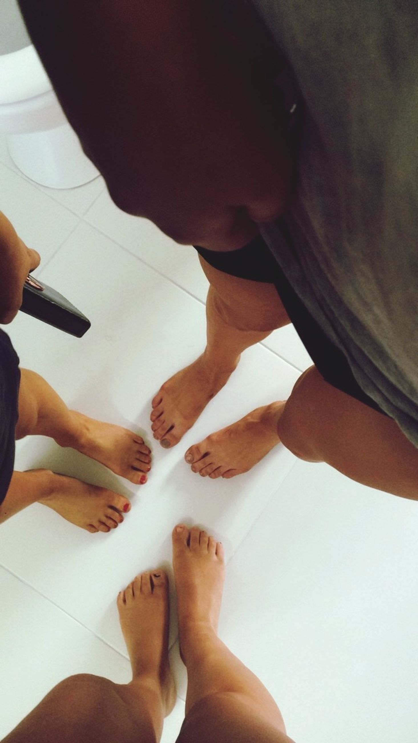 person, personal perspective, part of, lifestyles, low section, leisure activity, holding, cropped, barefoot, indoors, human finger, human foot, high angle view, men
