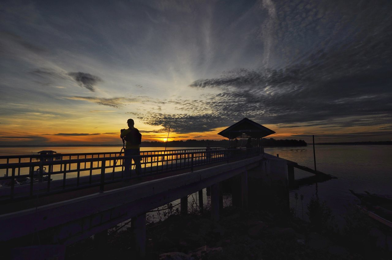 View of sunrise at Pulau Indah Malaysia fishing jetty. Sunset Railing Silhouette Sea Pier Travel Nature Sky One Person One Man Only Beauty In Nature Tranquility People Outdoors Only Men Full Length Scenics Vacations Sun Check This Out