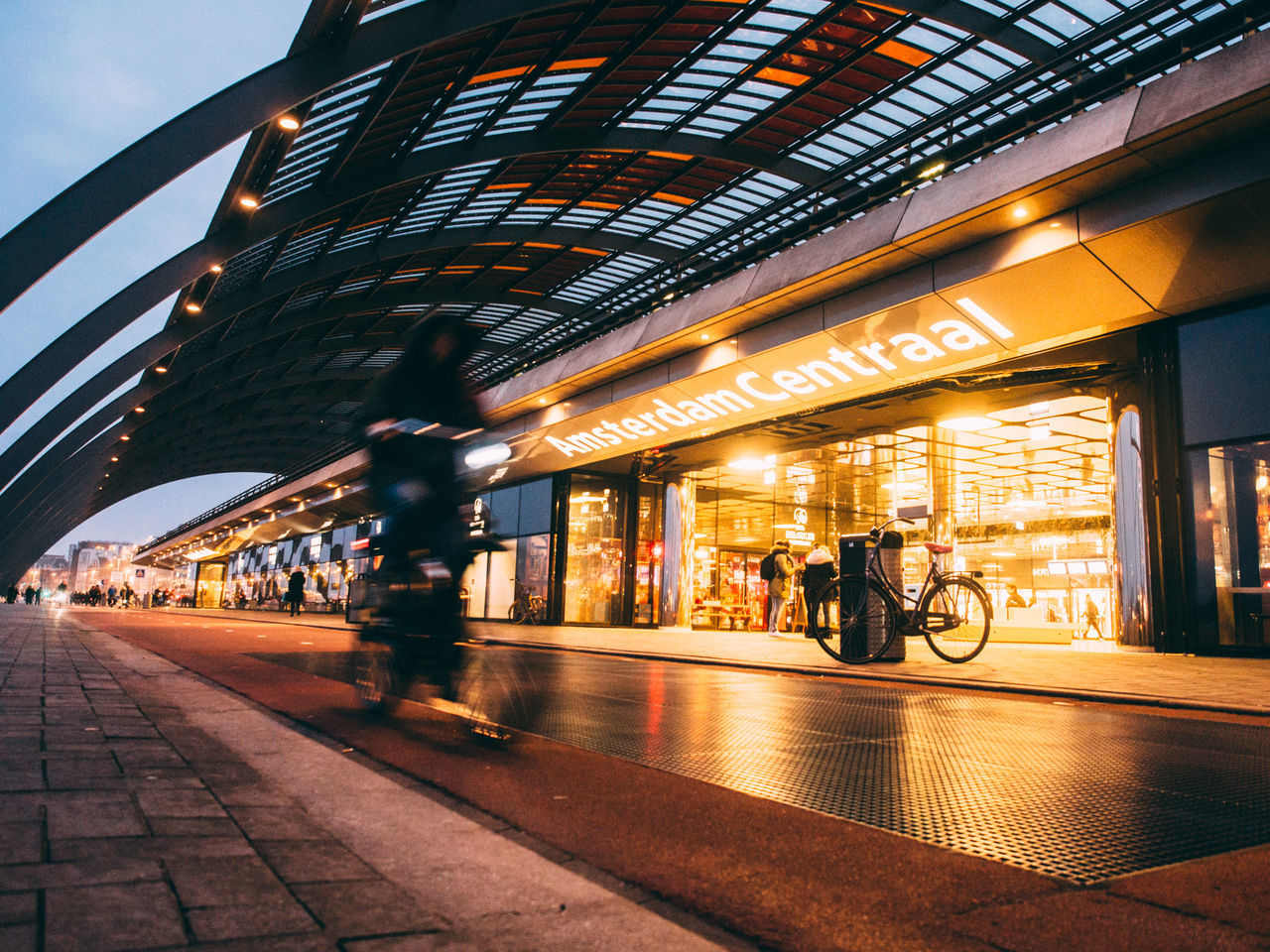 Amsterdam Architecture Blurred Motion Built Structure City Illuminated Lifestyles Motion Netherlands Night Outdoors People Public Transportation Railroad Station Real People The Street Photographer - 2017 EyeEm Awards Transportation