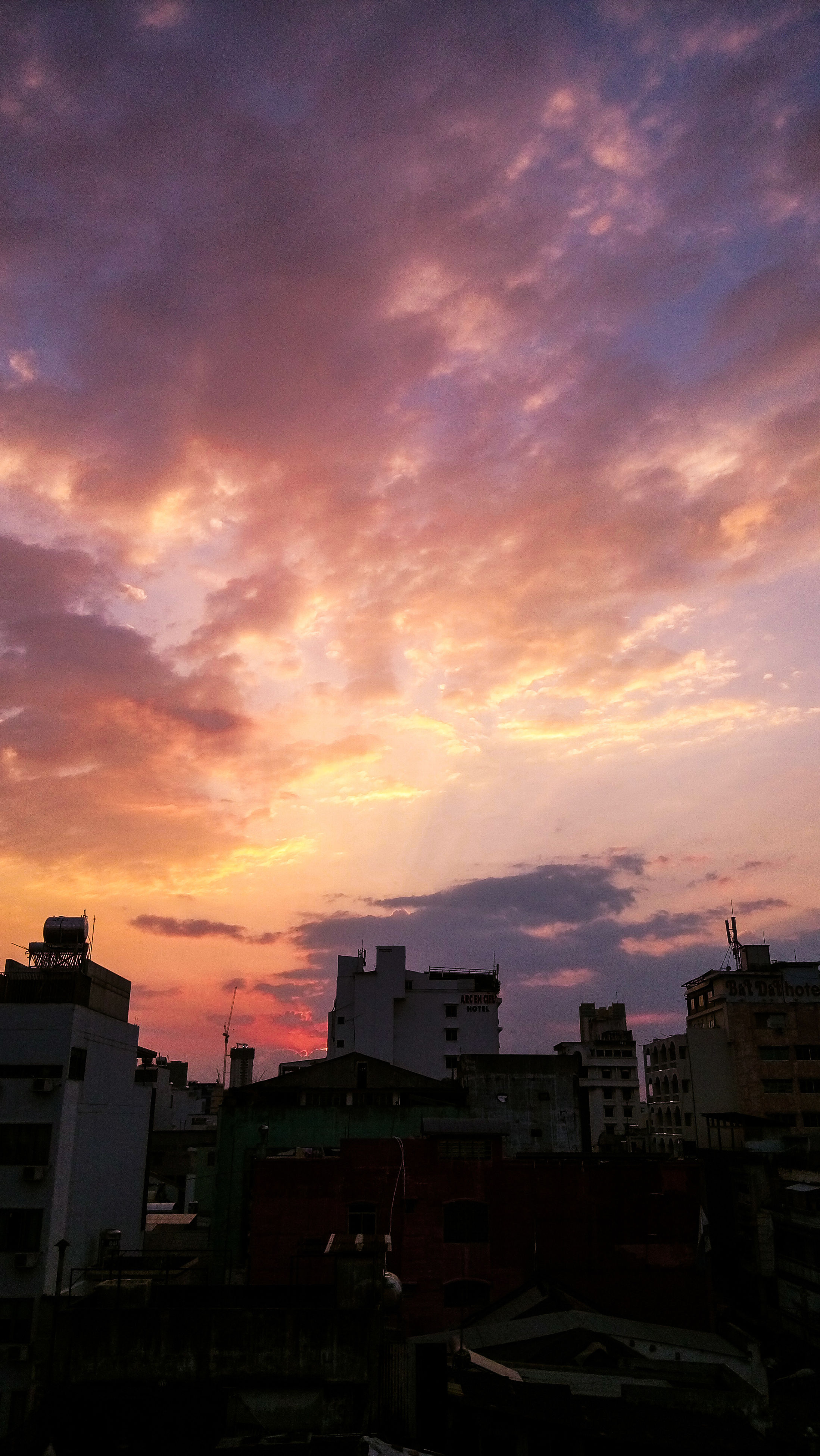 sunset, city, cityscape, architecture, building exterior, built structure, dramatic sky, sky, skyscraper, urban skyline, cloud - sky, residential building, outdoors, no people, beauty in nature, downtown district, nature
