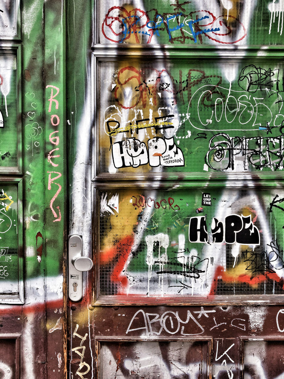 Door with Graffiti Berlin Close-up Color Colorful Colors Day Door Entrance Graffiti House No People Outdoors Text Vandalism