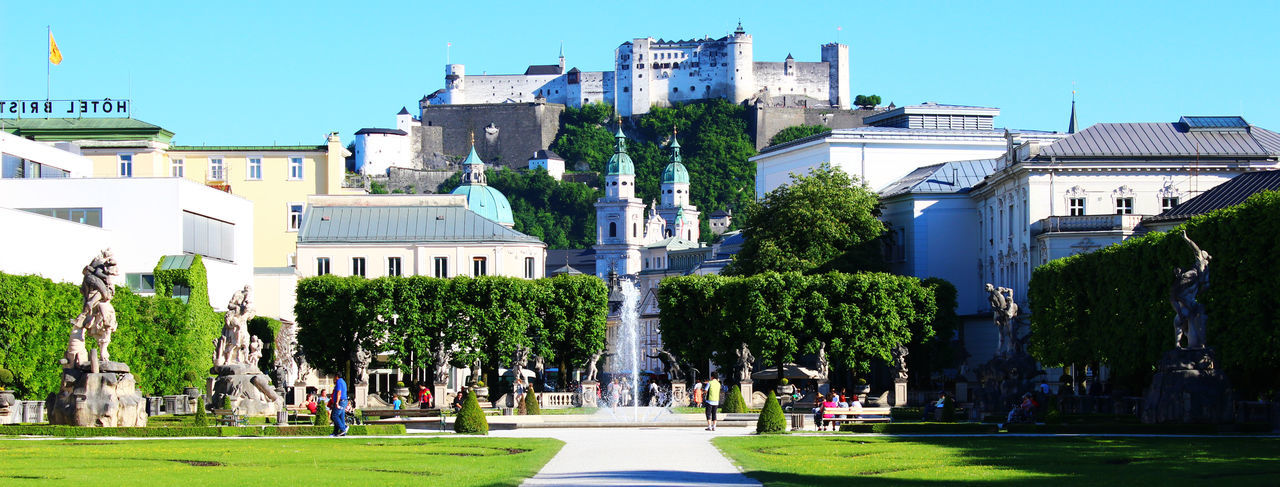 Architecture Building Exterior Built Structure Castle City Clear Sky Day Festung Hohensalzburg Fortress Fountain Grass Historical Historical Building Historical Monuments Historical Sights Hohensalzburg Large Group Of People Monument Nature Outdoors People Real People Salzburg Sky Tree