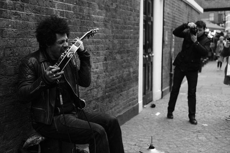 Musical Instrument Music Playing Adults Only Arts Culture And Entertainment Adult Musician People Only Men Men Young Adult Saxophone Performance Outdoors One Man Only Day Streetphotography Bnw