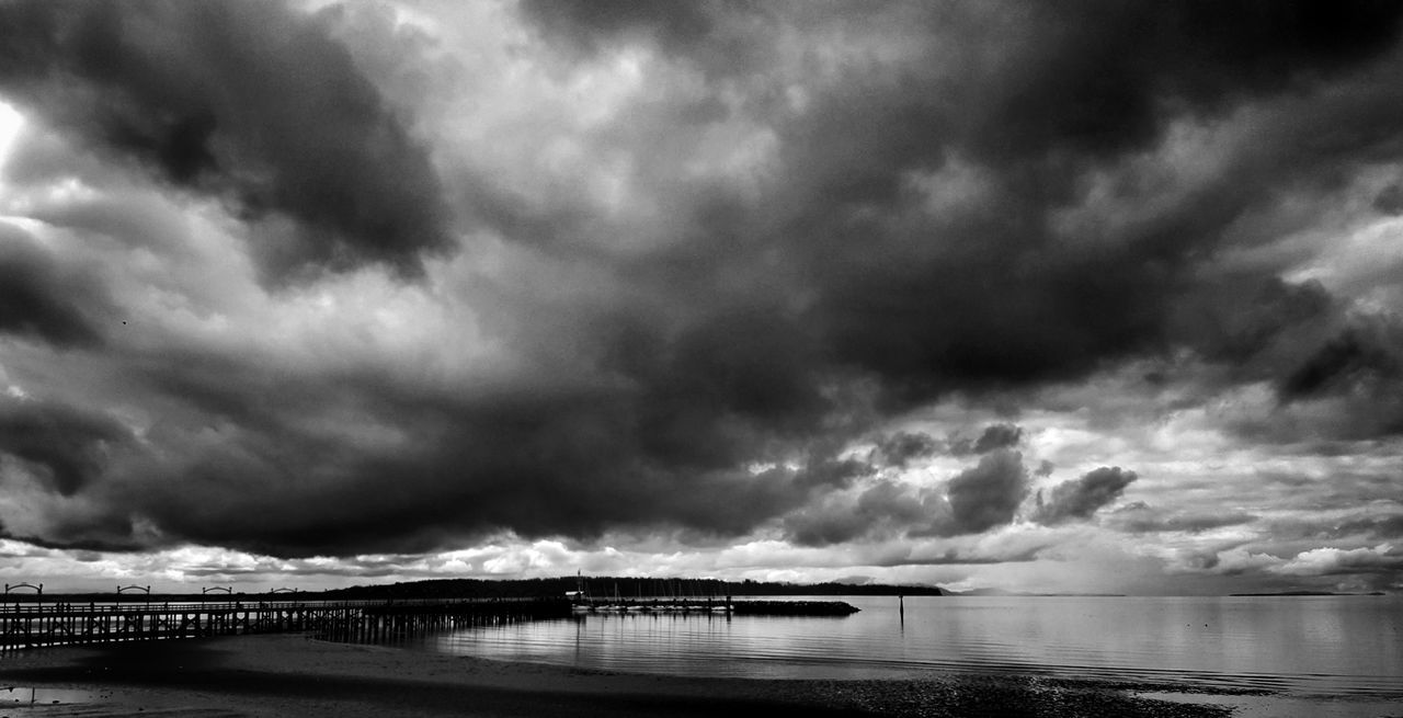 Dramatic Sky Cloud - Sky Sea Storm Cloud Water Outdoors Beach No People Thunderstorm Scenics Storm Built Structure Nature Architecture Landscape Sky Beauty In Nature Horizon Over Water Nautical Vessel Day Beauty In Nature Bridge - Man Made Structure Harbor Nature Freshness