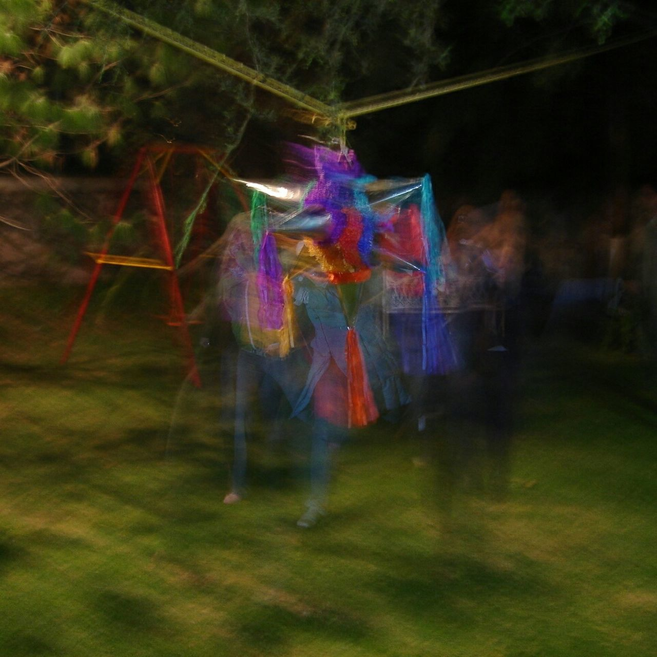 Tree Night Multi Colored Celebration Outdoors Hanging Spooky Grass Forest Full Length People One Person Nature Sky Only Men Movement Piñata